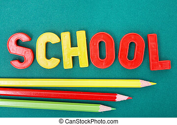 Pencils and letters - Image of word school with three...