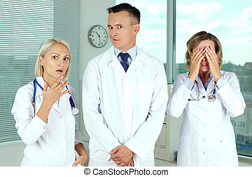 Serious case - Three clinicians in white coats in shock
