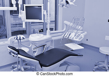 Dentist chair in blue - Desaturated image of dentist chair