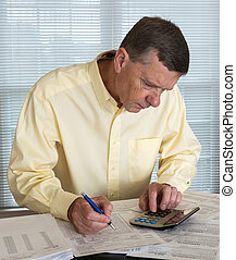 Senior man preparing USA tax form 1040 for 2012 - Senior...
