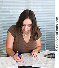 Young lady preparing USA tax form 1040 for 2012 - Young...