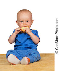 Adorable baby eating a bun - Adorable small baby sitting on...