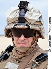 US marine in the desert uniform and protective military...