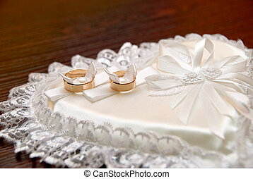 Wedding rings - Two wedding rings on a heart-shaped pad