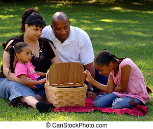Peek in the Picnic Basket - Young girl peeking in a picnic...