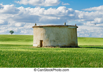 Cloudy wheat Field and Dovecote - An idilic scene of the...