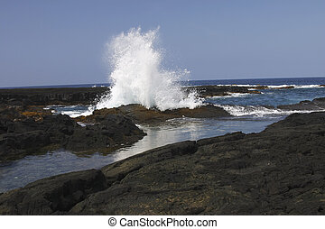 Hawaii Big Island - Waves crashing the beach at sunset on...