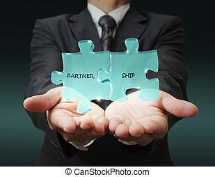 businessman shows quot;3d partnershipquot; written puzzle...
