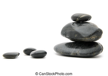 Feng Shui Black Stones - Balanced spa stones on white.