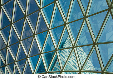 Glass windows grid on blue sky and building