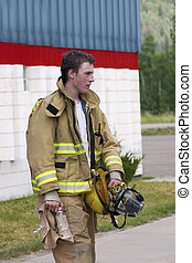 Fire is over - Young fireman tired after the fire is out