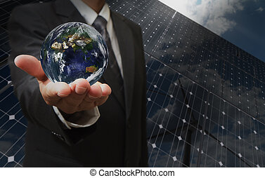 business man hand shows the earth as green energy concept...
