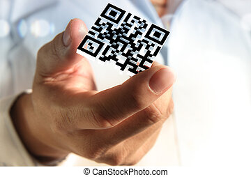 business hand shows 3d Qr code - close up of business hand...