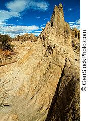 Natural Stone Pillar - A white stone pillar rising in...