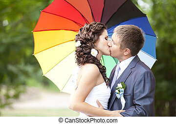 Young couple groom and bride kissing