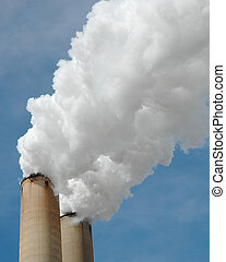 Smokestacks - Two smokestacks spewing billows of thick,...