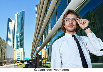 big city - Young business man standing on the street of the...