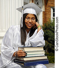 Studious Grad - Studious, smiling graduate resting on the...