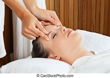 Female Receiving Head Massage At Spa