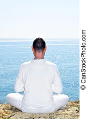 meditation - someone dressed in white meditating on the...