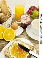 tasty breackfast with toast and marmelade on table - tasty...