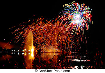 Magrnificient fireworks over a lake - Impressive, bright and...