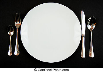 Dinner Setting - A place setting for dinner against a black...