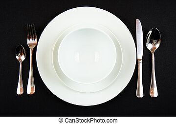 Place setting for dinner - A place setting at a dining table...