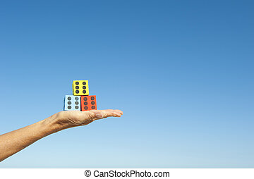 Hand and dices sky background - Hand and dices on hand...