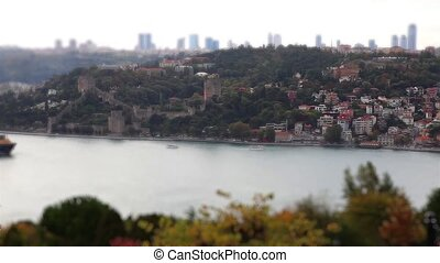 container ship passing bosphorus - miniature effect...