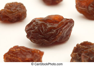 raisins - several dried raisins on white background