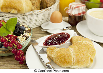 traditional french breakfast on table in morning -...