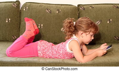little girl play with tablet pc