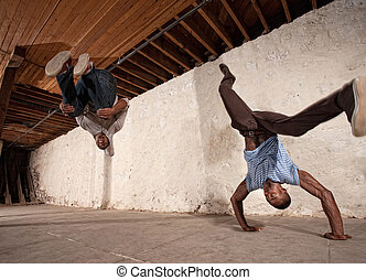 Capoeria Back Flip and Headstand - Two acrobatic capoeria...