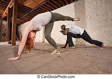 Capoeria Spinning Back Kick - Capoeria artist performs...