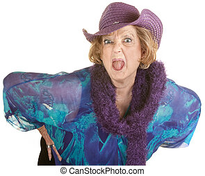 Woman Sticking Out Her Tongue - Angry senior woman in hat...
