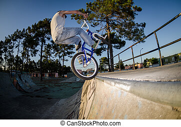 BMX Bike Stunt tap - Bmx rider performing a tap at a quarter...