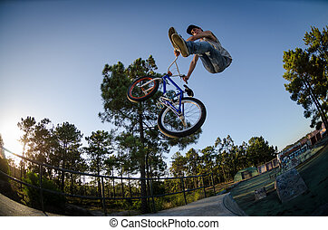 BMX Bike Stunt can-can - Bmx rider performing a can-can at a...