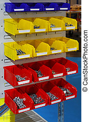 Sorting parts bins - Colourful plastic sorting bins with...