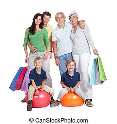 Happy generations family with shopping bags