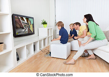 Young family playing videogames - Young family having fun...
