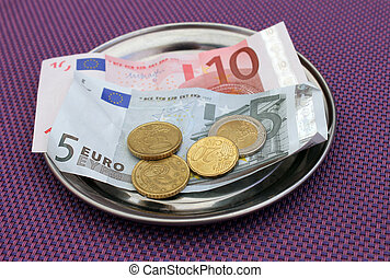 Euro tips on restaurant table - Euro tipsand payment for...