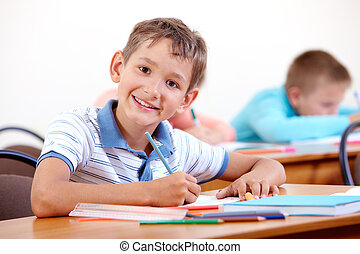 Studying at school - Portrait of smart lad looking at camera...