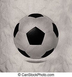 soccer football on wrinkled paper texture