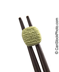 wasabi - close up of wasabi pellet on chopsticks
