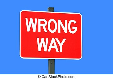 Wrong Way Sign - Bright red wrong way sign isolated against...