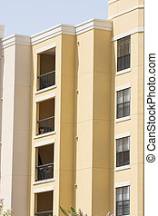 Yellow Condos with Wrought Iron Balconies