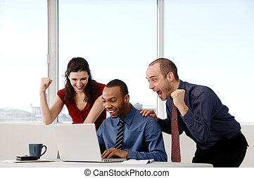 business Team - business team in an office on a laptop