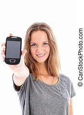 Teenager holding up a mobile phone - Pretty friendly smiling...