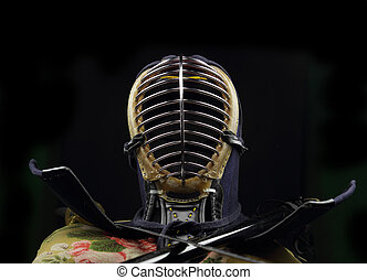 Kendo concept over black background - Kendo Helmet and...